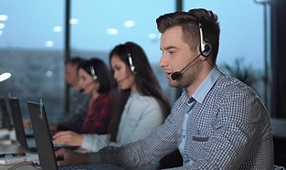 Young-man-in-call-center-695974420_3840x