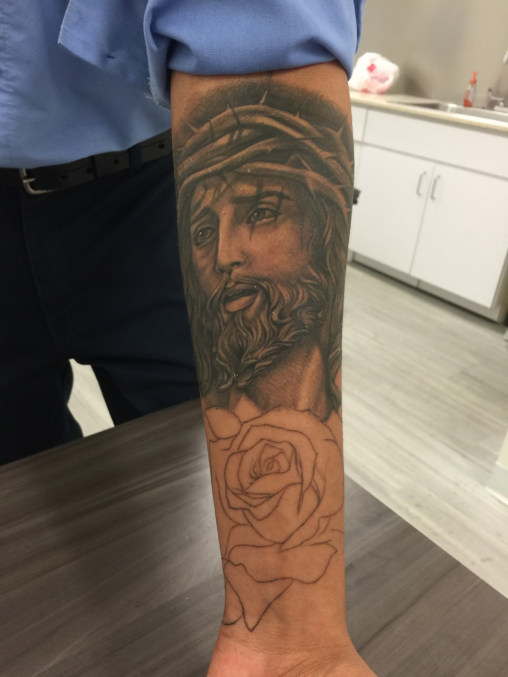 Tearful Jesus tat, with as yet unfinished rose