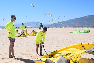 Guys Who Inflate a Kite Surf