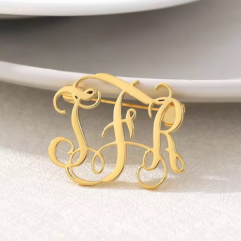 MONOGRAM BROOCH.