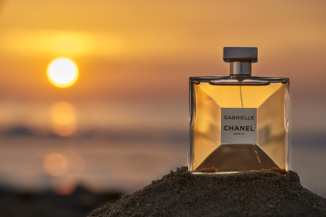 Gabrielle Chanel with sunrise in background