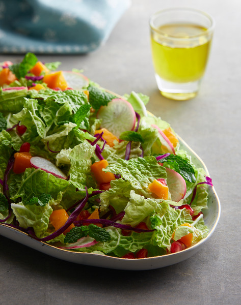 Mango Radish Salad with dressing.