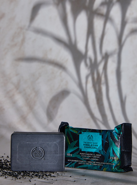 Body Shop Himalayan Charcoal soap shown with bamboo.