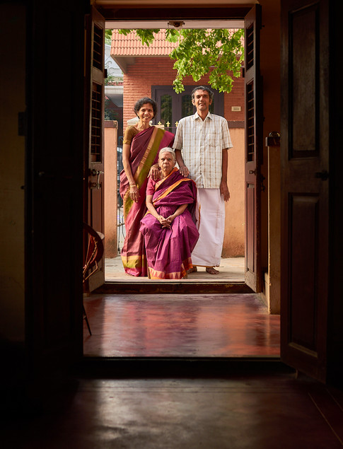 Portrait of a family in rustic indian house