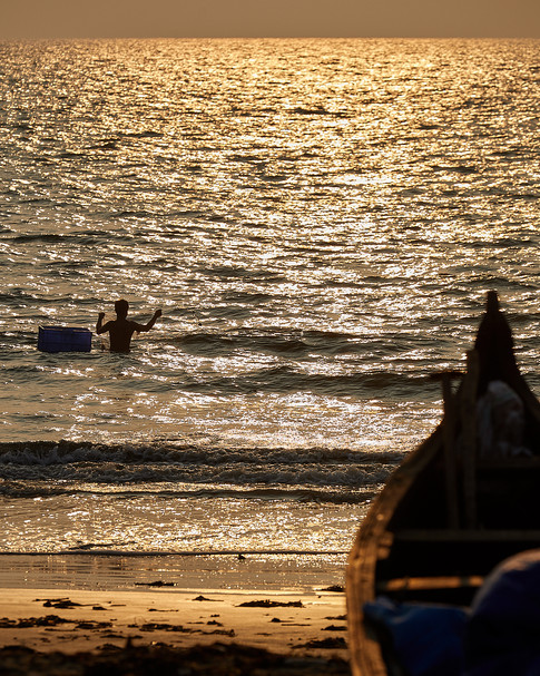 Fisherman at work in the sea