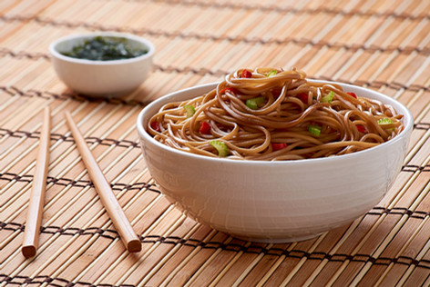 Noodles in a bowl with chopsticks.