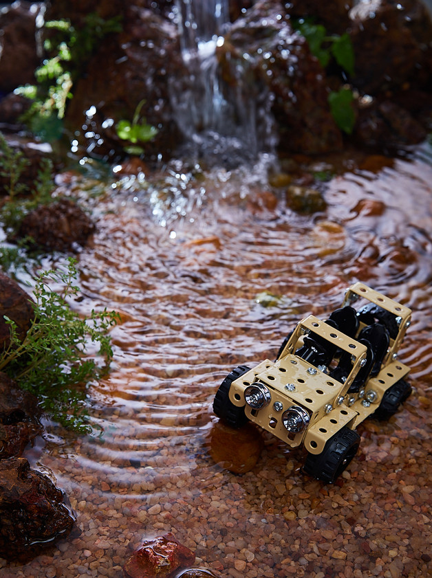 Mechanix toy shown in a natural waterfall setting.