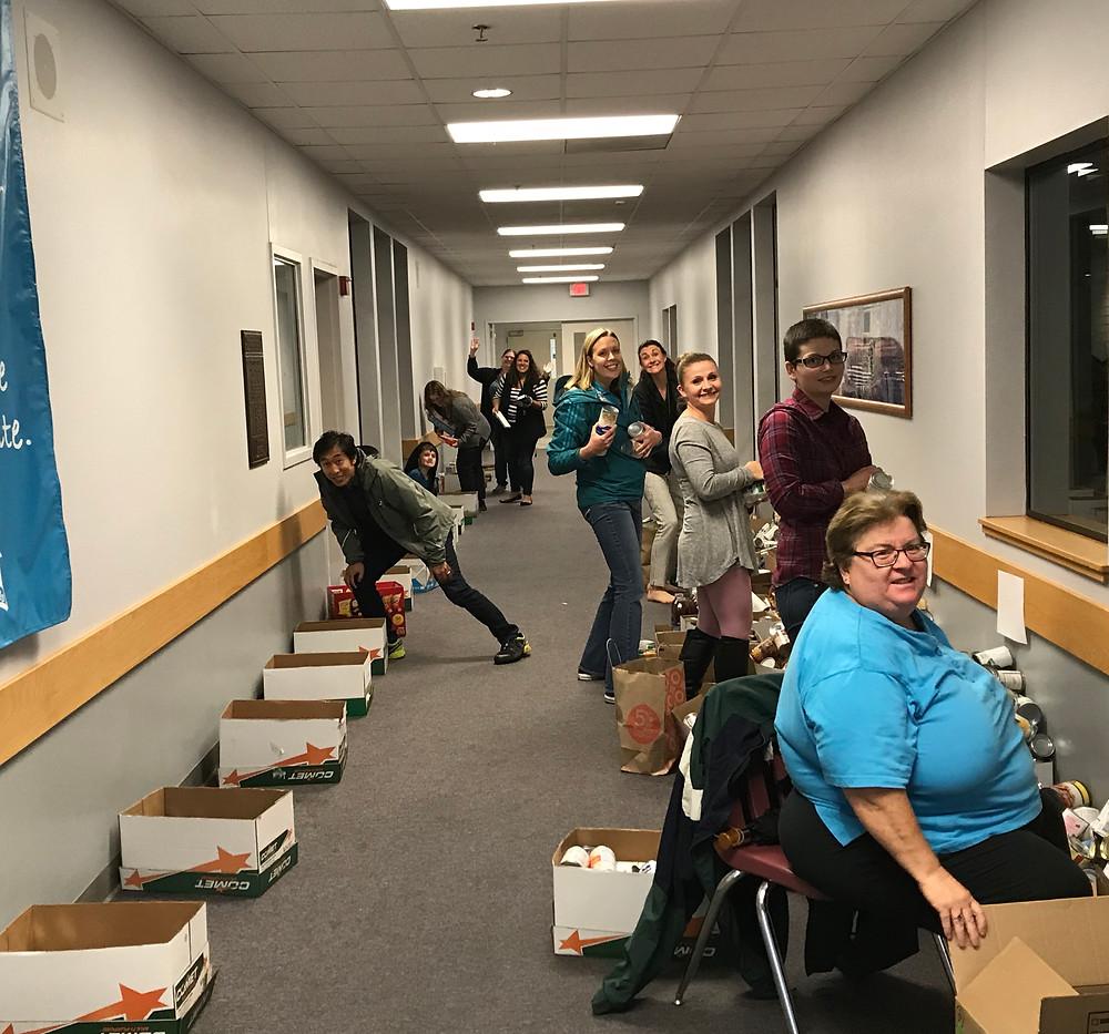Parent Volunteers Sorting the Food