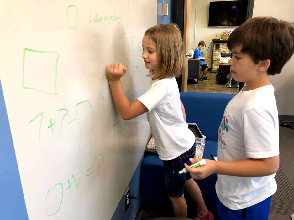 Kids drawing on whiteboard