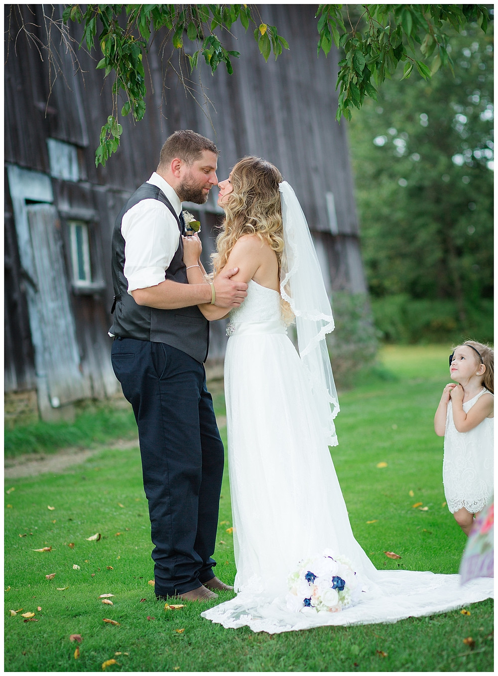 If you couldn't tell they are truly in love, you can definitely see if in the dreamy look of the flower girl watching them.