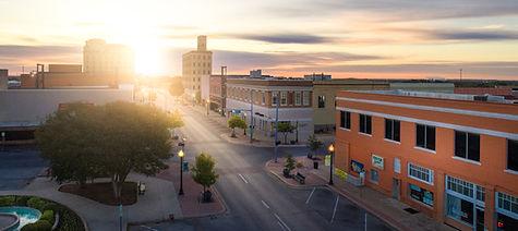 stock-photo-small-town-sunrise-241459361