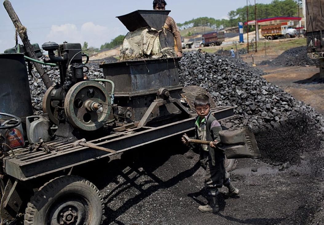 Young Boy Shovelling Coal