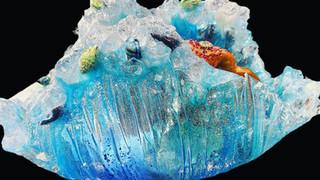 Detail: resin, shells, ink, quartz crystals, mirror pieces.