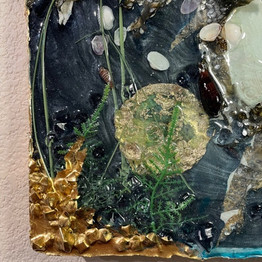 Detail of gold ink and start of resin edges of flower impressions