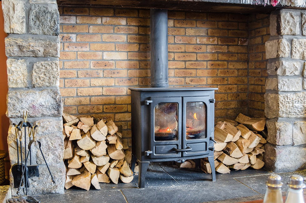 Tradional Wood Burning Stove in a Brick Fireplace