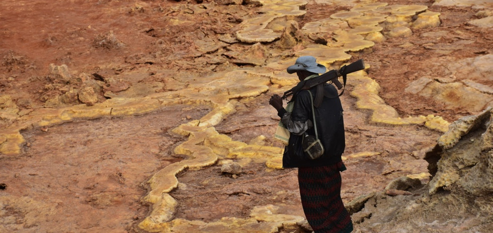 Our guard in the sulphur lake of the Danakil