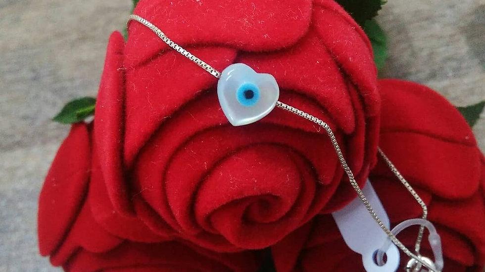 Ponto de luz olho grego coração