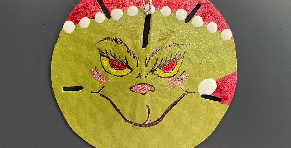 Grinch face sand dollar