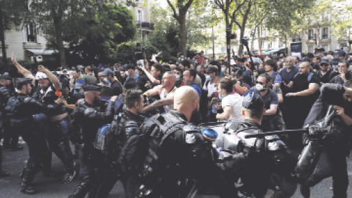 Large COVID-related protests hit France, Italy and Australia