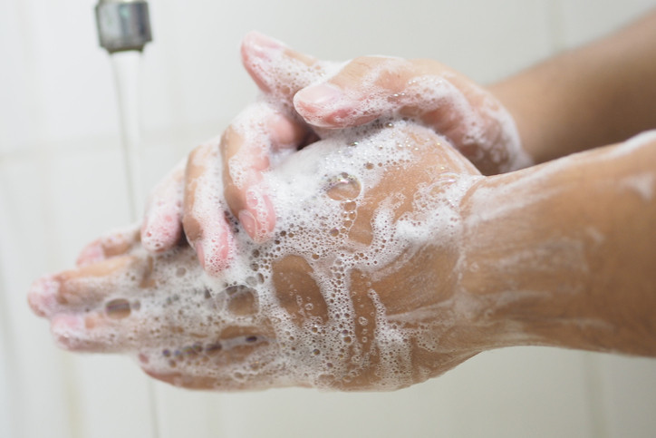 Hands are cleaned under running water with antiseptic soap.