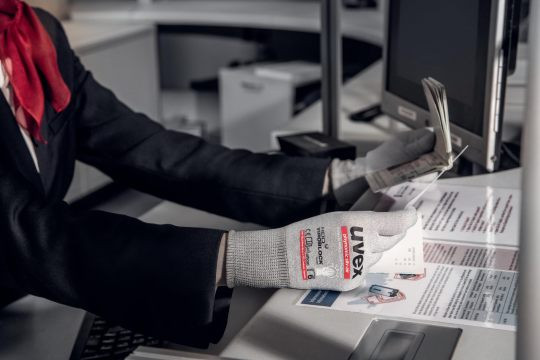 An employee wears Uvex gloves against viruses and bacteria.