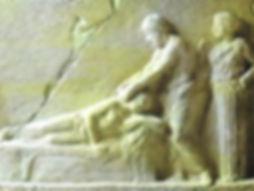 Bas-relief d'un magnétiseur qui traite