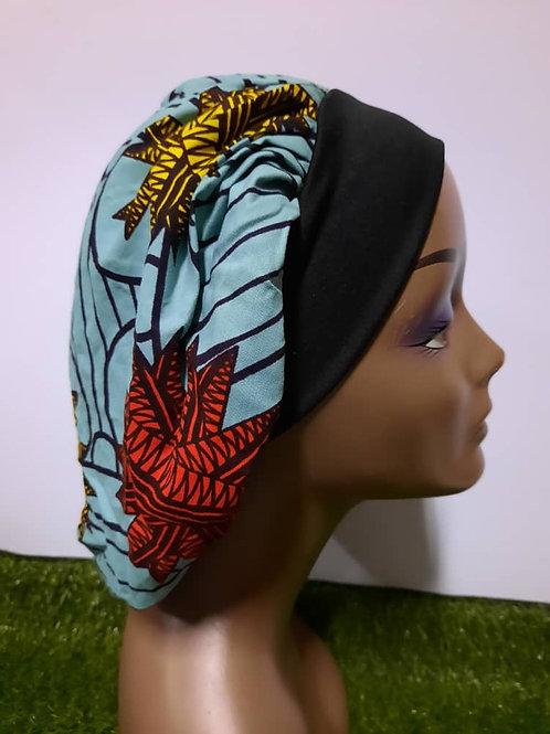 Bonnet bande noire motif bleu pâle/rouge/jaune