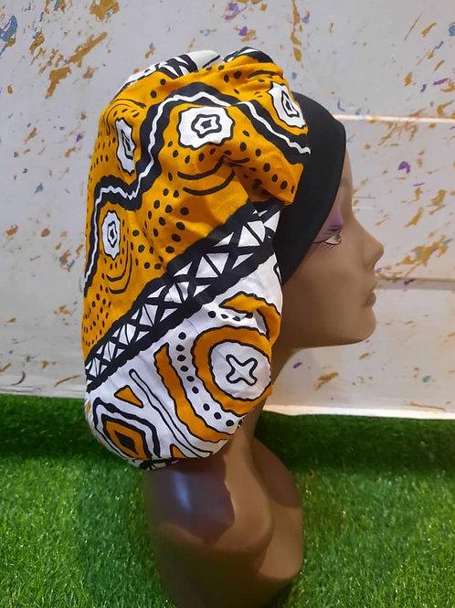 Bonnet bande noire motif noir/blanc/orange