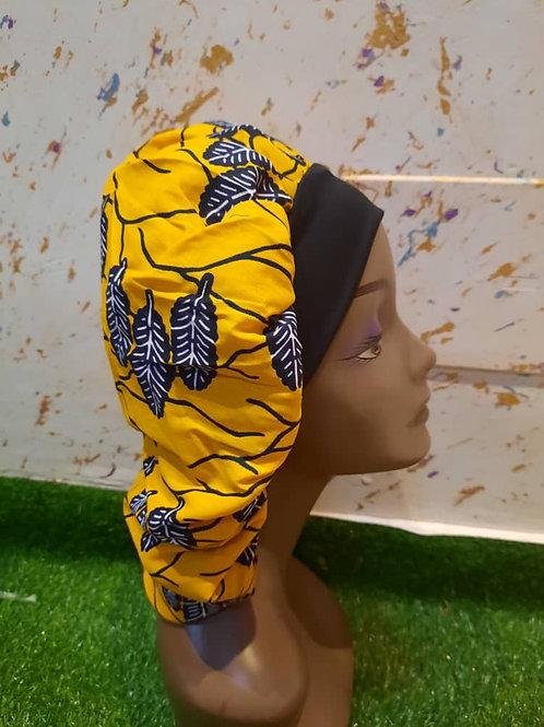 Bonnet bande noire motif jaune et plumes