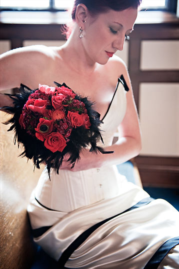 Custom bridal ensemble of overbust corset and matching skirt in ivory satin with black trim and accents