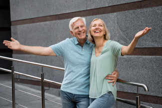 happy-senior-couple-posing-together-outd