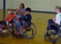 on-basketball-court-three-kids.jpg