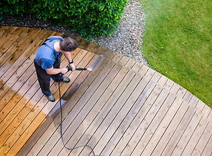 man cleaning terrace with a power washer
