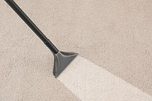Removing dirt from carpet with vacuum cl