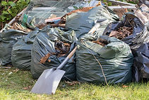 Garden rubbish in refuse sacks stored du