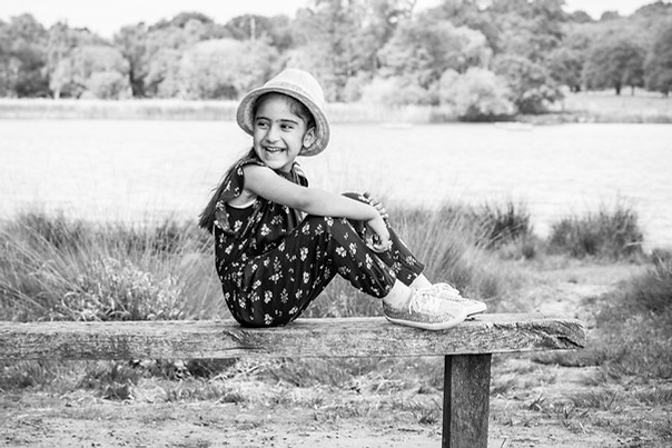 Black and white portrait photography of girl on bench