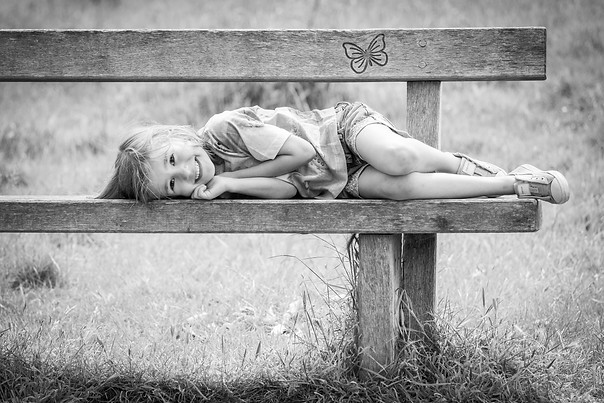 Photography of girl on bench outdoors