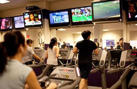 runners on treadmills watching TV