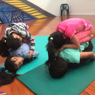 Balasana on top of each other