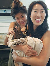 two women holding and petting a baby wallaby in maryland