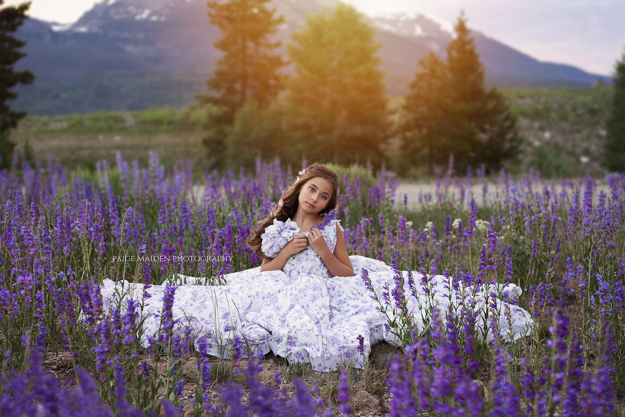 girl sitting in a field of flowers
