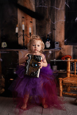 little girl with a spell book