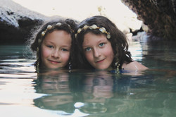 two girls in the water with seashell