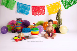 baby at a fiesta themed cake smash