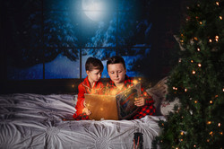 brothers reading a christmas book