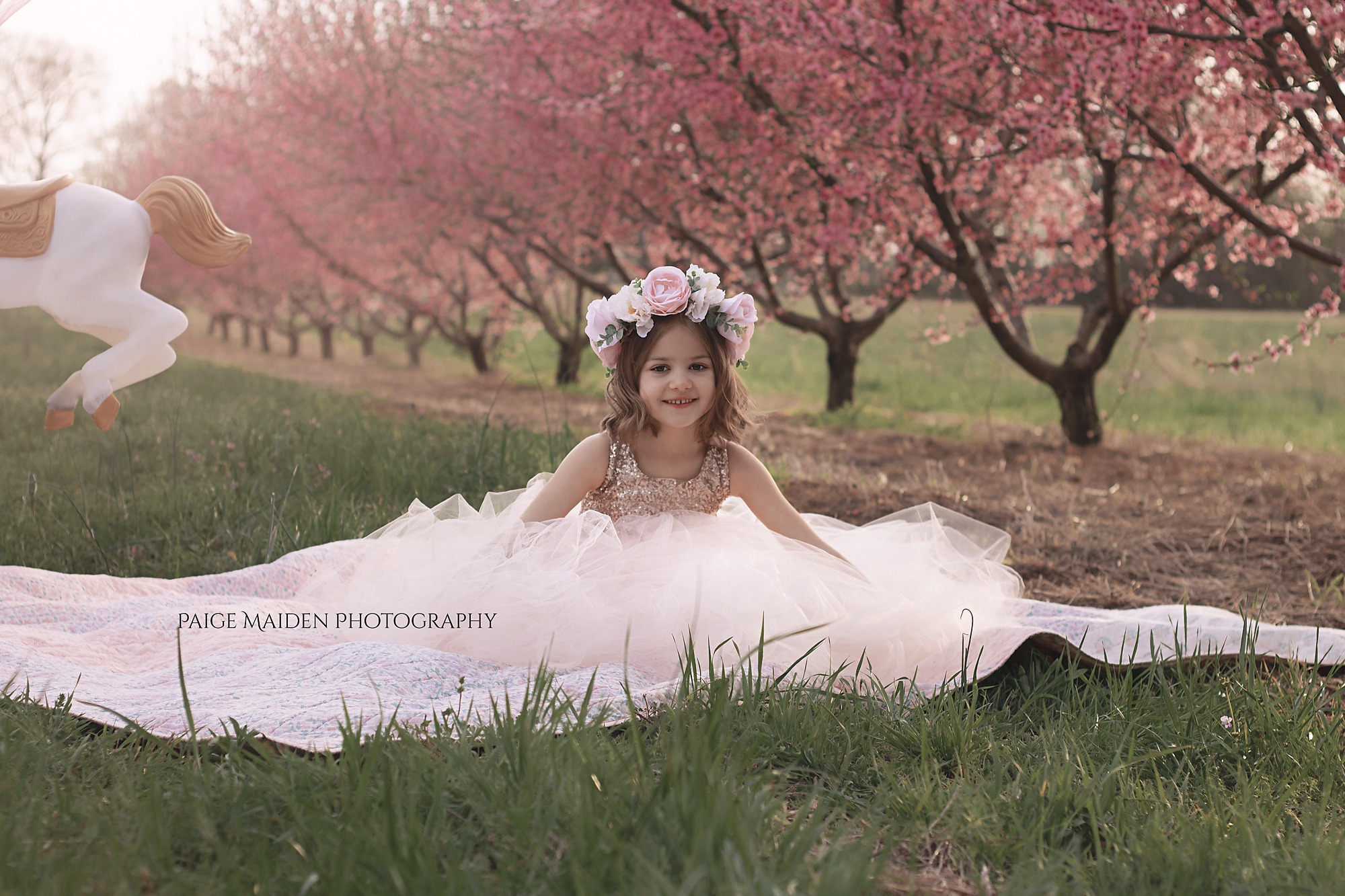 girl in a pink dress with peach tree