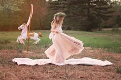 girl twirling in pink dress