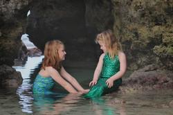 sisters in mermaid costumes