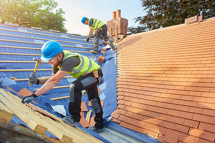 two men repairing replacing a roof on a home | Vogt's Hometown Roofing | Boerne San Antonio roofers