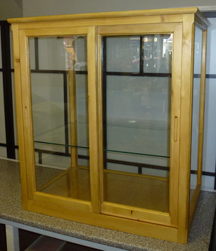 display cabinet with sliding doors.